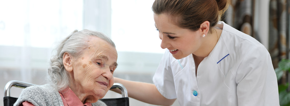 nurse smiling at elderly man